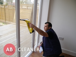 Professional AB Cleaner During a Window Cleaning