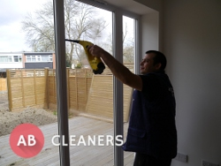 Expert AB Cleaner Sanitising a Window