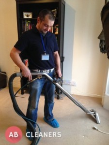 AB Cleaner Vacuuming a Carpet